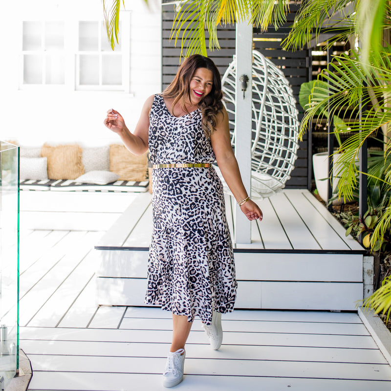 Stacey  wearing our Brooke cami - animal print tucked into our Kutira midi skirt - animal print with a belt.