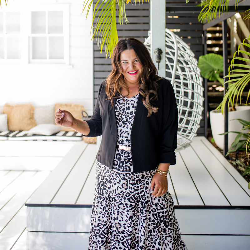 Stacey wearing our Karen scuba jacket - black with our  Brooke cami - animal print, our  Kutira midi skirt - animal print and a belt