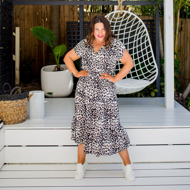 Stacey in our Whitney midi dress - animal print paired with white sneakers