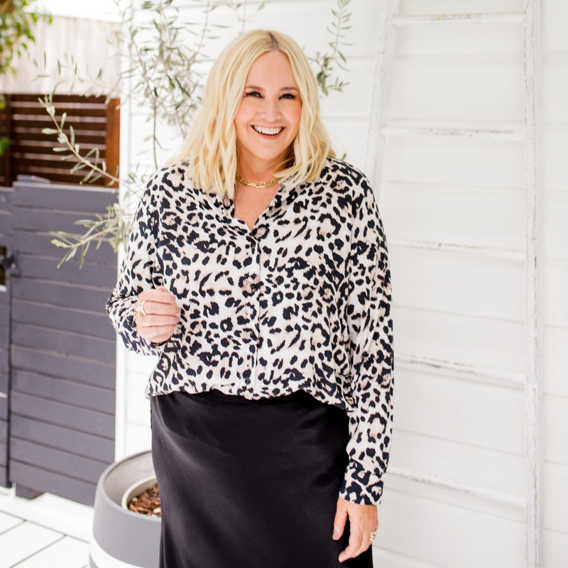 Nikki wearing our Simone animal print shirt tucked into our Deborah midi skirt black