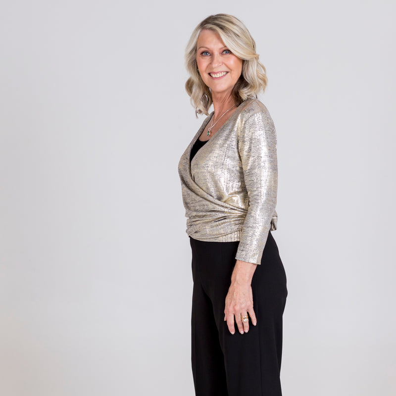 Susan wrap cardi gold, styled with Laura side zip wide leg pant black.