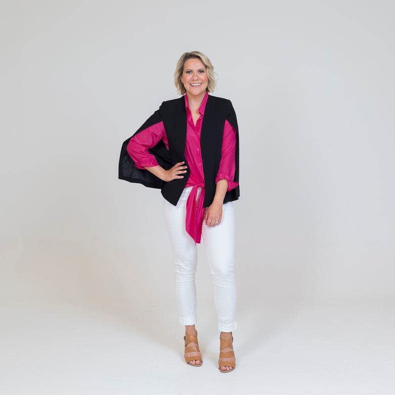 Kirsten cape - black, paired with a pink long sleeve top, white jeans and nude heels