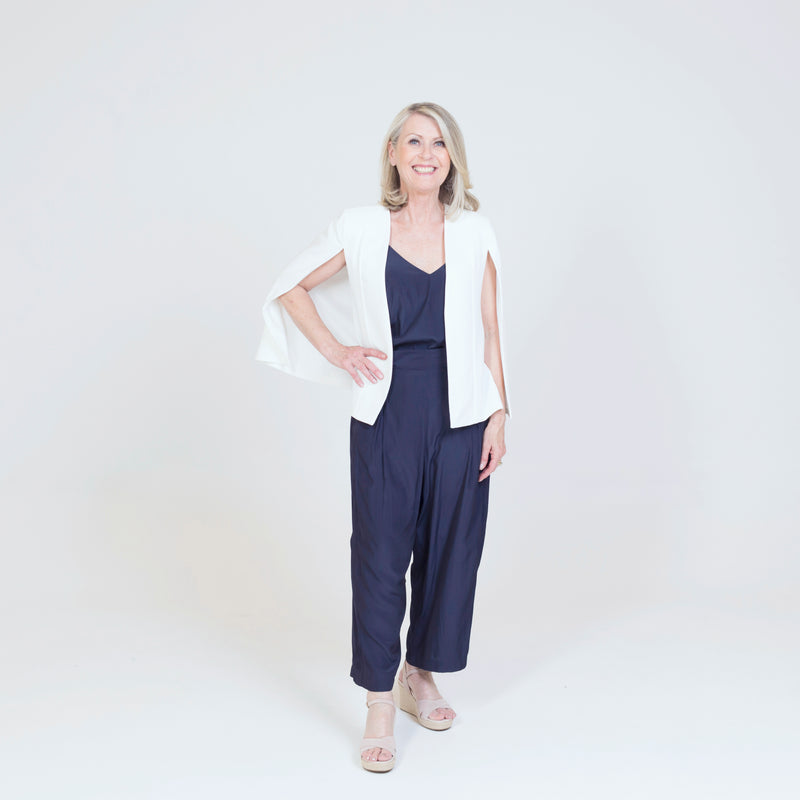 Kirsten cape - ivory paired with our Rachel Cami in navy, our Maddy technical pants in navy and nude heels