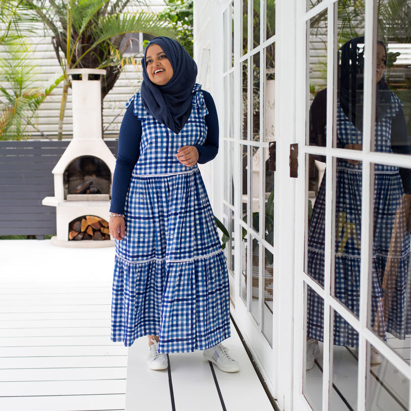 Faaiza wearing our Vanessa tie-shoulder dress in gingham with a navy long-sleeve tee and navy Hijab.