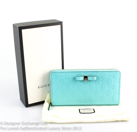 Gucci Turquoise Bow Signature Zip Around Wallet (1)