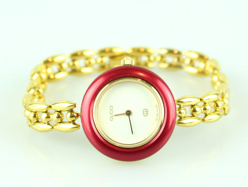 Gucci Gold Plated Chain Bracelet Watch With 5 Metal Interchangeable Bezels
