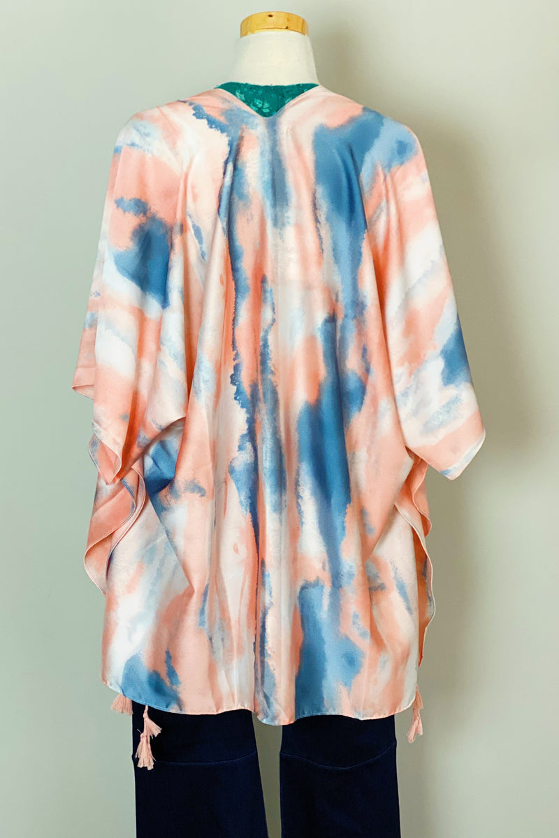 The back of the Bright Skies Tie Dye Kimono in Pink Shown on a mannequin