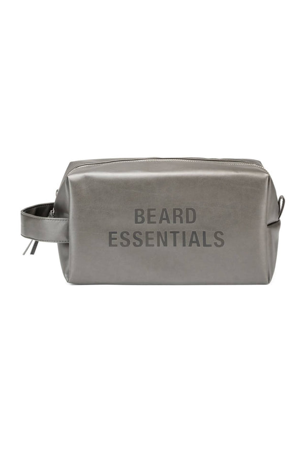 The grey beard essentials dopp kit in front of a white background.