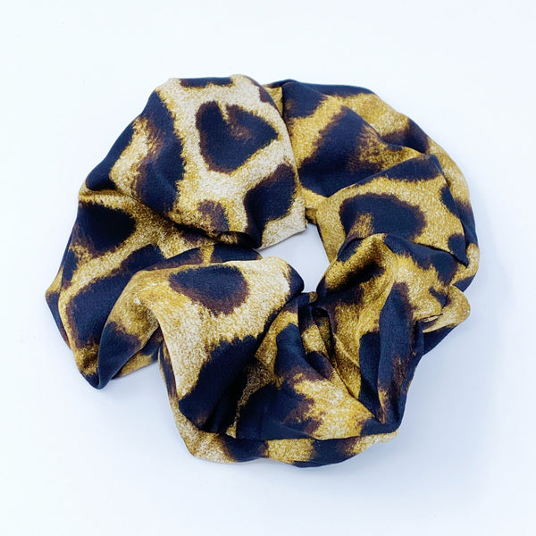 Giant leopard print scrunchie displayed on white background