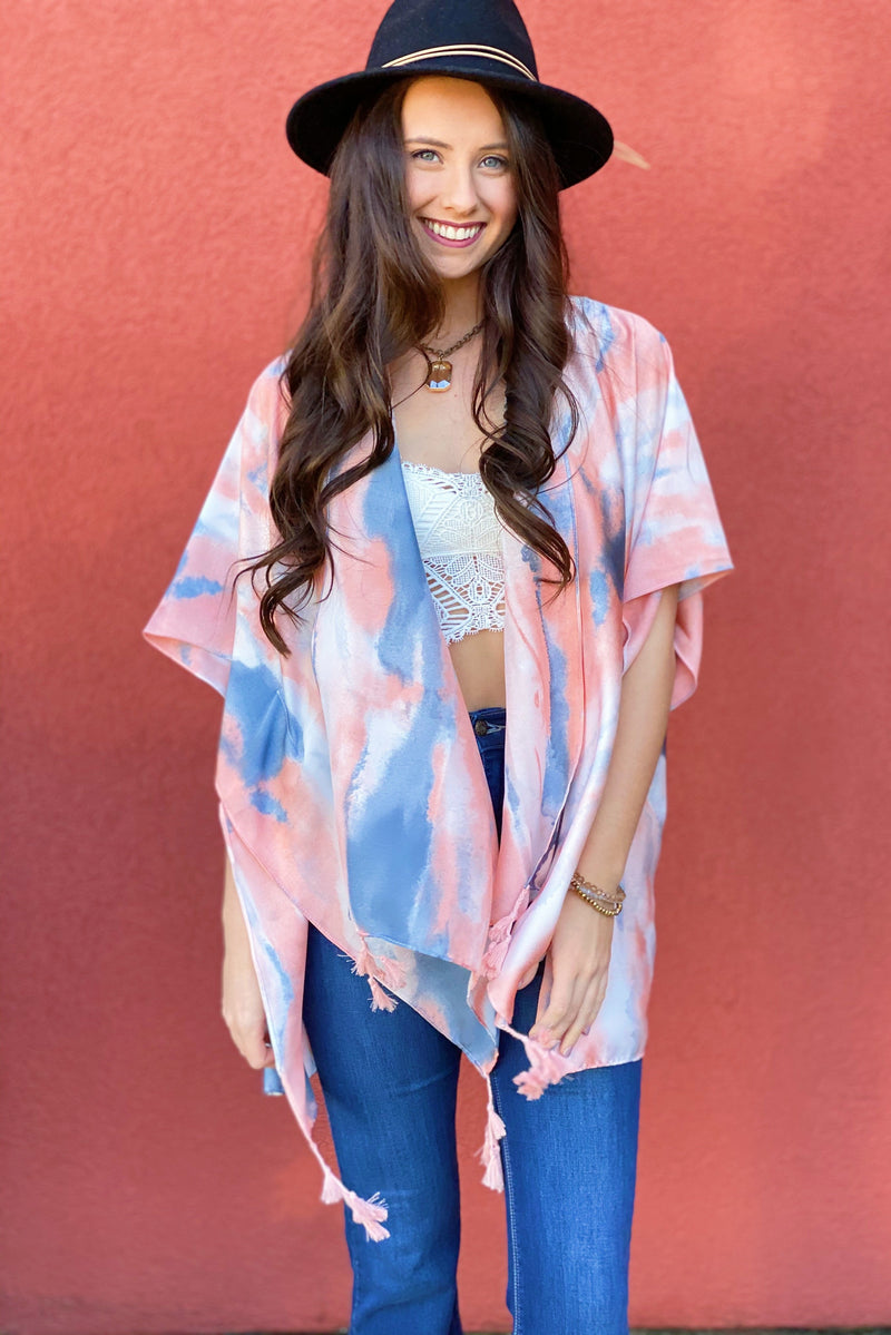 Model showing off the front of the Bright Skies Tie Dye Kimono in Pink