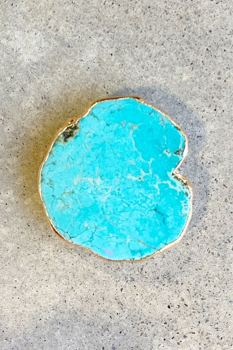 The beauty of nature Stone phone grip shown in turquoise with gold trim.