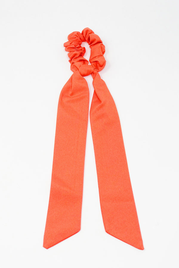Trendy orange hair scrunchies from online clothing Boutique Ellison + Young make the perfect hair accessory