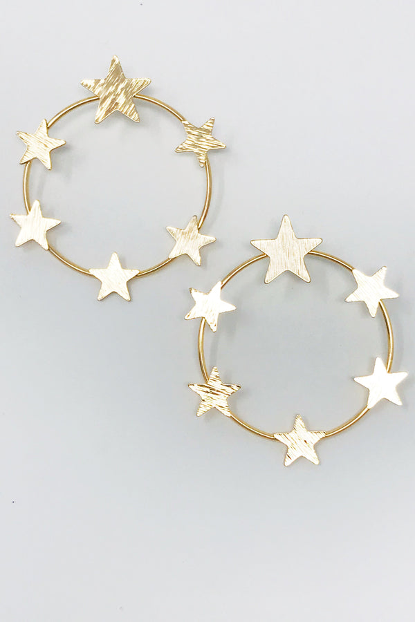 gold star detailing around a circle hoop earring displayed on white background