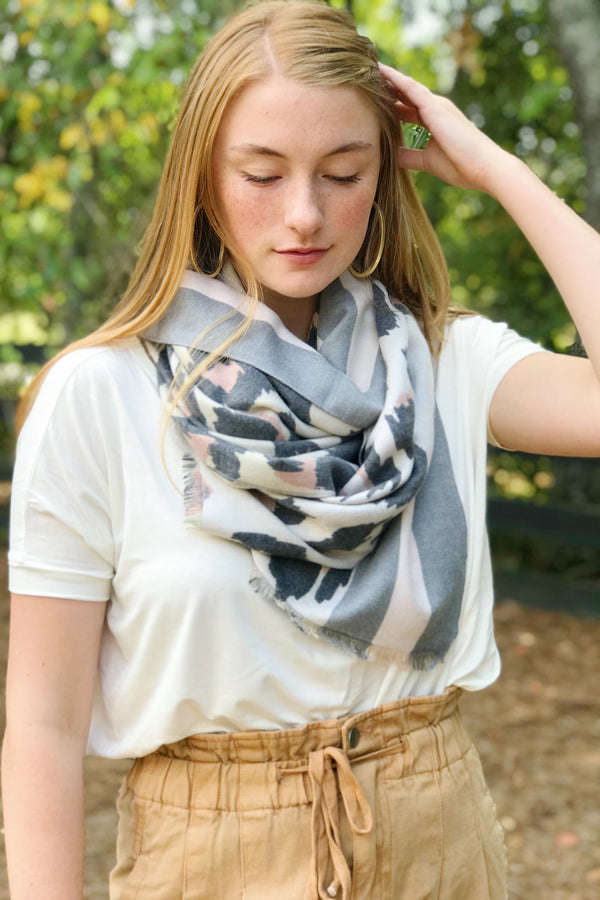Model wearing leopard print scarf from online Boutique Ellison + Young