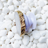 The side view of the Beauty of Nature Stone Phone Grips in white druzy showing the gold edges and the grip.
