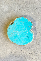 Beauty of nature stone phone grip in turquoise with gold trim.