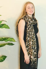Model wearing Gold Leopard print scarf from online Boutique Ellison + Young