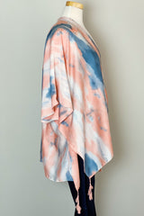 The side of the Bright Skies Tie Dye Kimono in Pink shown on a mannequin