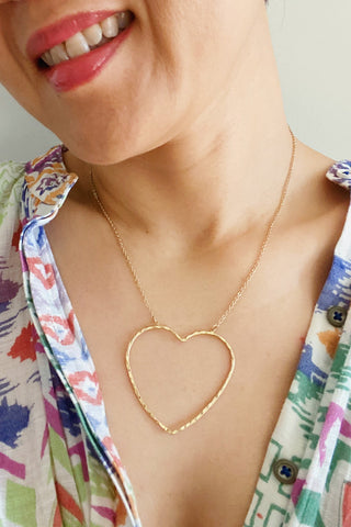 Big Heart to Love, Gold necklace shown on a model.