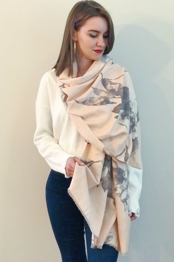 Model wearing a cashmere pink floral print scarf from online Boutique Ellison + Young
