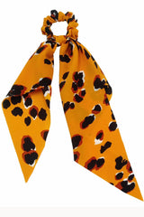 Orange leopard print scarf scrunchie displayed on white background