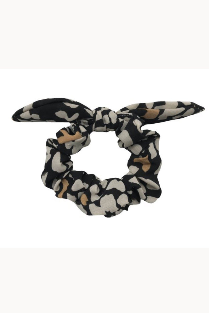 Black leopard print bow scrunchie displayed on white background