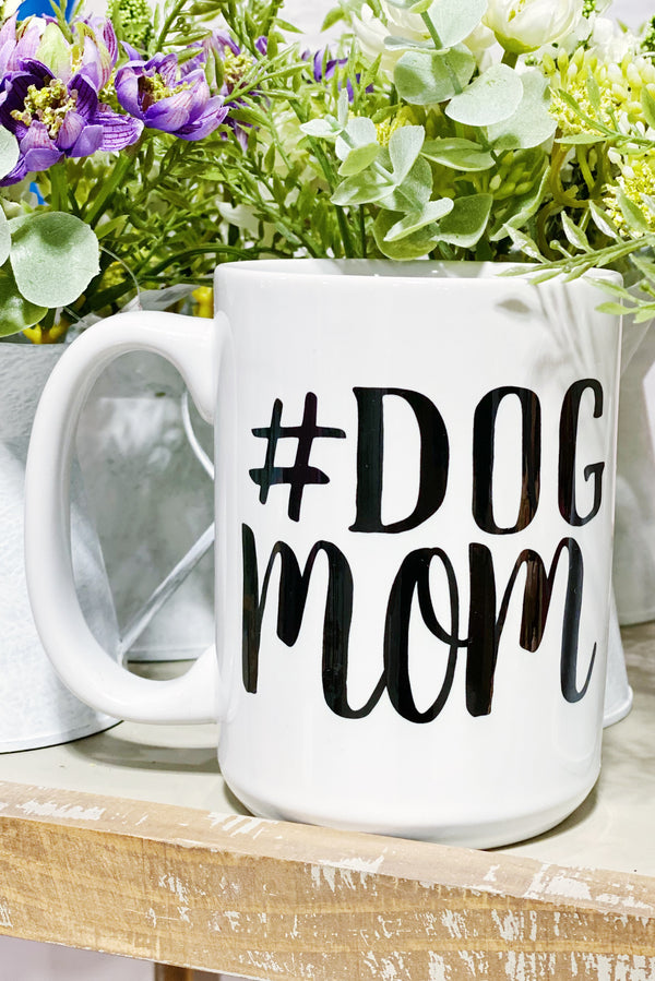 White Mug that has #Dog Mom printed on the mug in black text