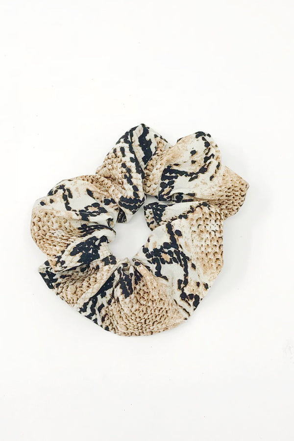 Trendy brown snake skin hair scrunchies from online clothing Boutique Ellison + Young make the perfect hair accessory