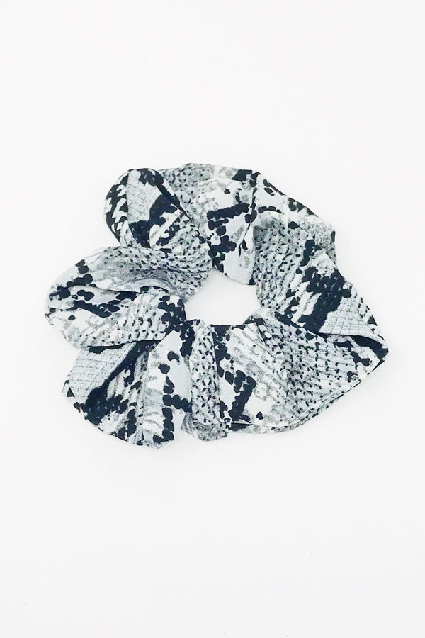 Trendy Gray snake skin hair scrunchies from online clothing Boutique Ellison + Young make the perfect hair accessory