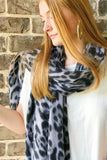 Model wearing black Leopard print scarf from online Boutique Ellison + Young