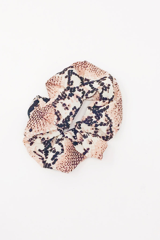 Trendy pink hair scrunchies from online clothing Boutique Ellison + Young make the perfect hair accessory