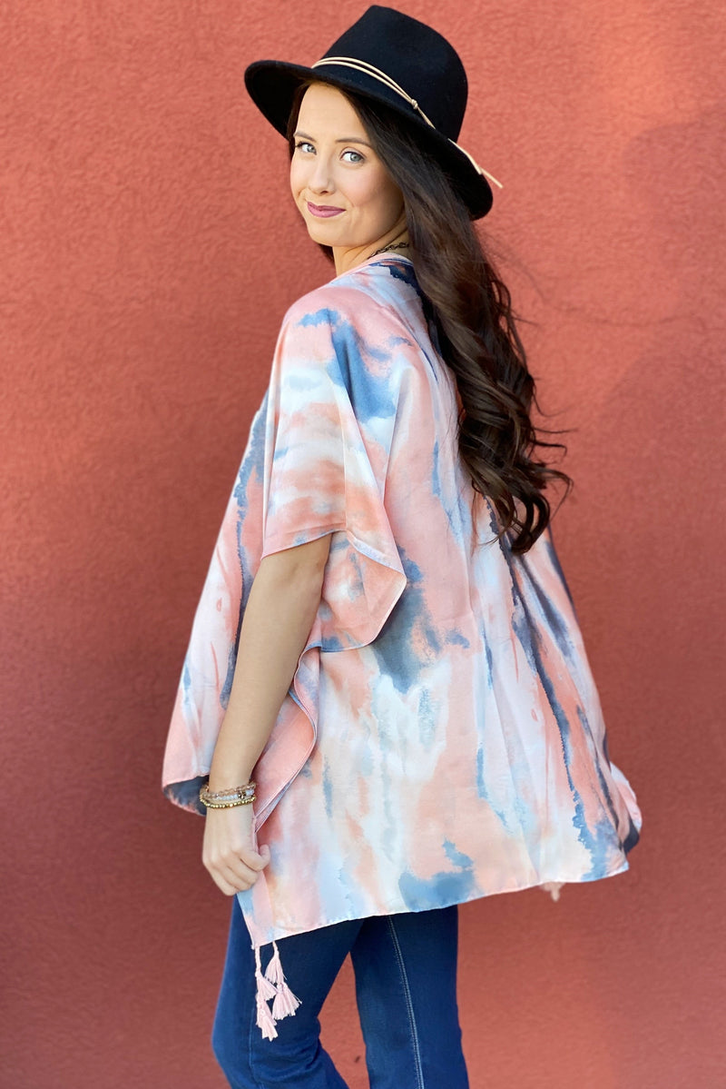 Model wearing the Bright Skies Tie Dye Kimono in Pink showing off the back of the kimono