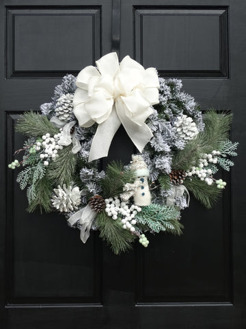 Flocked Pine Wreath with Snowman, Green & White Berries and Pine Cones