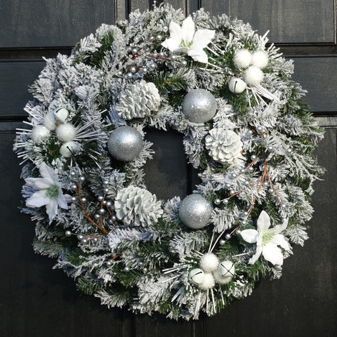 Silver and White Flocked Winter Jingle Bell Wreath with Artificial Poinsettias, Pine Cones, Berries and Decorative Ball Ornaments