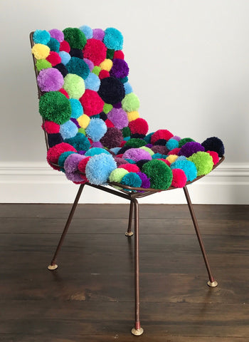 pom pom chair made by pony mctate crocheter using wool yarn