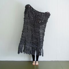 giant chunky woolen yarn blanket made in new zealand using merino sheep wool with xxl knitting needles with added tassles