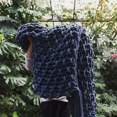 Create this chunky arm knitted blanket using the moss stitch. We used five chunky wool merino bumps of Plump & co 2 ply blue/indigo yarn, with Giant 45mm Needles from Plump & Co. in New Zealand and Australia. With chunky wool merino knits and layers of textures for your home inspiration.