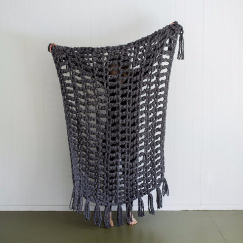Large crochet bed throw made using Plump & Co chunky yarn
