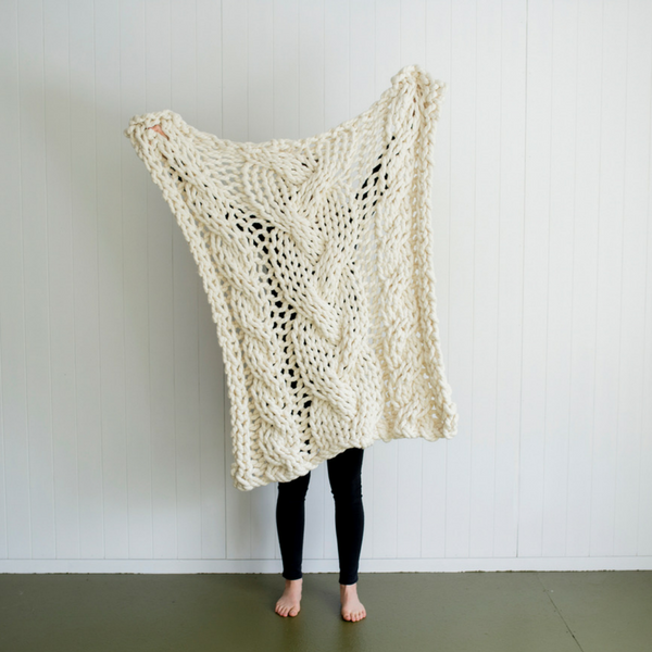 411508de2e142 Knit your own beautiful chunky yarn blanket to add texture to your home.