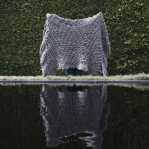 Create this chunky arm knitted blanket using the Herringbone stitch. We used five chunky wool merino bumps of Plump & co 2 ply grey yarn, with Giant 45mm Needles from Plump & Co. in New Zealand and Australia. With chunky wool merino knits and layers of textures for your home inspiration.