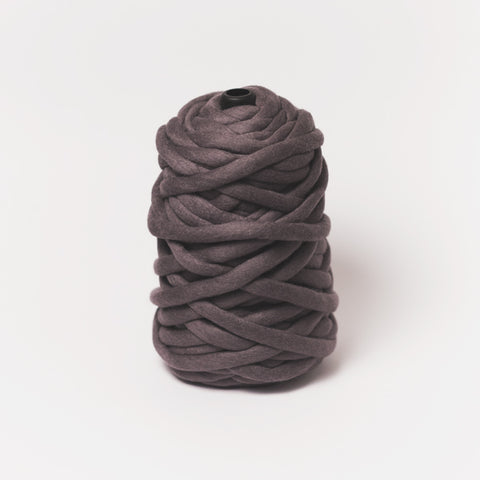 Plump & Co's giant yarn in midnight 1 ply. Use our plumptious XXL New Zealand merino wool with our giant knitting needles or extreme crochet hooks to make your own chunky knit blanket or throw. Individual bumps and extreme knitting kits available. Worldwide shipping, free shipping to New Zealand and Australia!