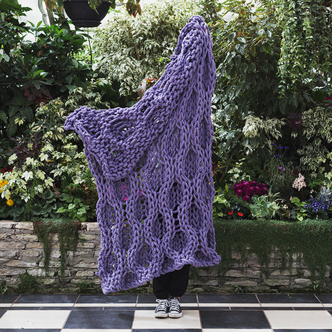 Create this chunky arm knitted blanket using the honeycomb stitch. We used chunky wool merino bumps of Plump & Co 1 ply white and purple yarn, with Giant 45mm Needles from Plump & Co. In New Zealand and Australia. With chunky wool merino knits and layers of textures for your home inspiration.