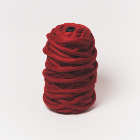 Plump & Co's giant yarn in red 1 ply. Use our plumptious XXL New Zealand merino wool with our giant knitting needles or extreme crochet hooks to make your own chunky knit blanket or throw. Perfect for arm knitting. Worldwide shipping, free shipping to New Zealand and Australia!