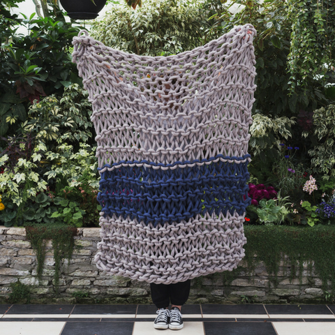 Create this chunky arm knitted blanket using the plain Garter stitch. We used chunky wool merino bumps of Plump & Co 1 ply grey and blue yarn, with Giant 45mm Needles from Plump & Co. In New Zealand and Australia. With chunky wool merino knits and layers of textures for your home inspiration.