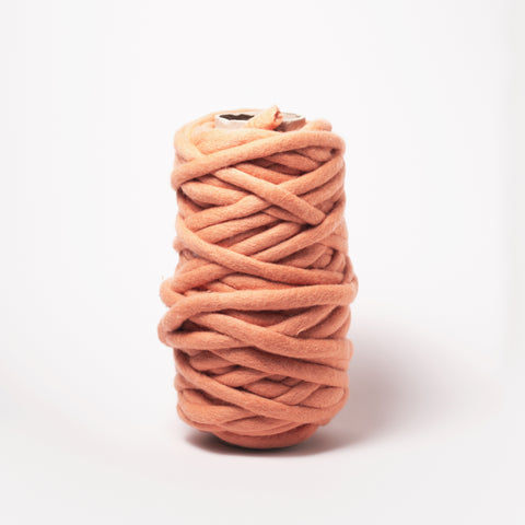 Plump & Co's giant yarn in Apricot Coral Orange 1 ply. Use our plumptious XXL New Zealand merino wool with our giant knitting needles or extreme crochet hooks to make your own chunky knit blanket or throw. Perfect for arm knitting. Worldwide shipping, free shipping to New Zealand and Australia!