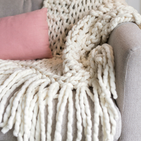 Chunky yarn blanket knitted using Plump & Co 2 ply merino yarn