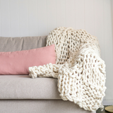 Knit your own beautiful chunky yarn blanket to add texture to your home.