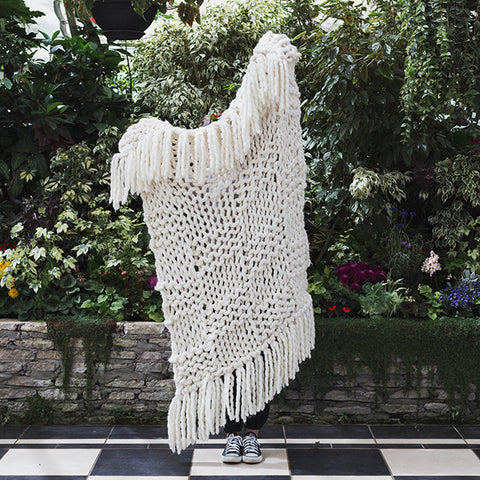 Create this chunky arm knitted blanket using the basket knit stitch. We used five chunky wool merino bumps of Plump & co 2 ply white yarn, with Giant 45mm Needles from Plump & Co. in New Zealand and Australia. With chunky wool merino knits and layers of textures for your home inspiration.