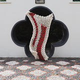 Create this chunky arm knitted blanket using the plain garter knit stitch. We used chunky wool merino bumps of Plump & Co 1 ply white and red yarn, with Giant 45mm Needles from Plump & Co. in New Zealand and Australia. With chunky wool merino knits and layers of textures for your home inspiration.
