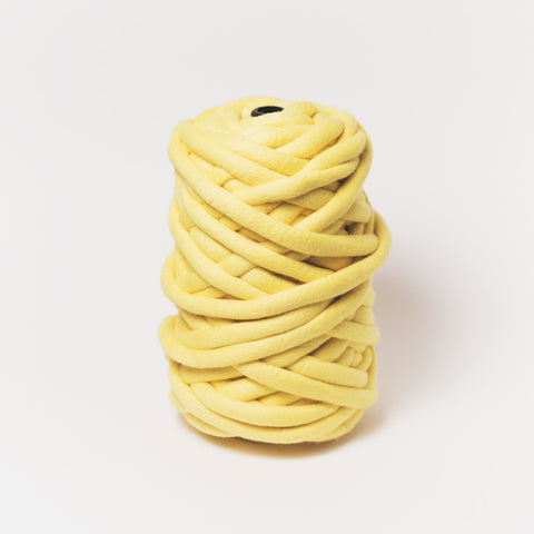 Plump & Co's giant yarn in yellow 1 ply. Use our plumptious XXL New Zealand merino wool with our giant knitting needles or extreme crochet hooks to make your own chunky knit blanket or throw. Perfect for arm knitting. Worldwide shipping, free shipping to New Zealand and Australia!